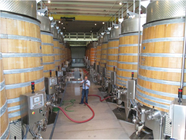 The unique hybrid open top fermenters used in the Horizon program at the Castello Banfi Winery.