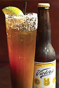 At Mercadito, guests choose the beer base for their Michelada, which gets its Bloody Mary-like accents from lime, Tabasco, Worcestershire and salt. Courtesy of Mercadito Hospitality.