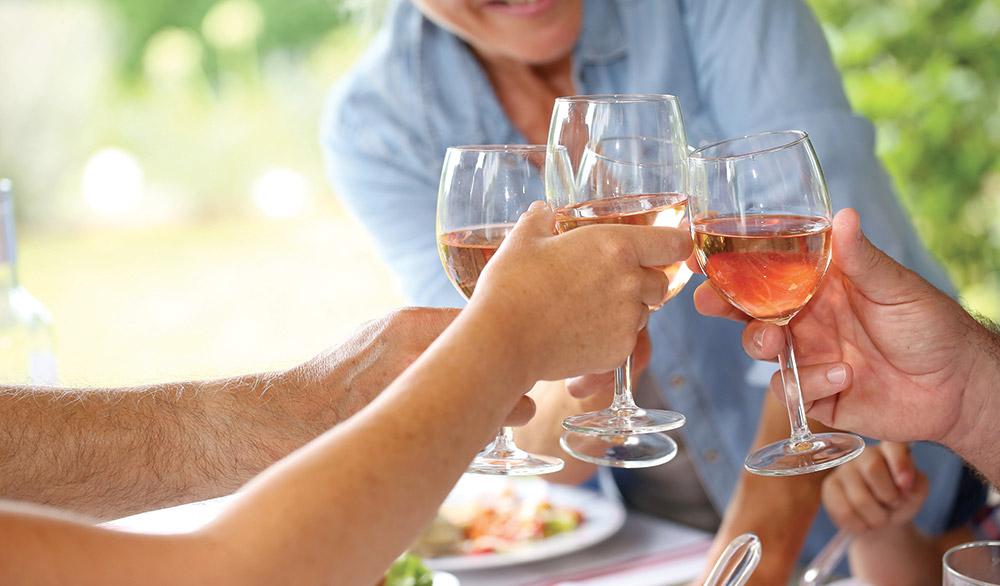 bigstock-Closeup-of-wine-glasses-held-b-73116589
