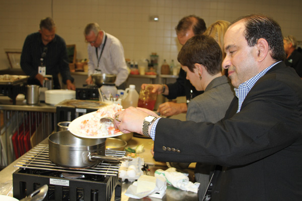 Daniel Hoffman, Marriott International, working on his team's dish.