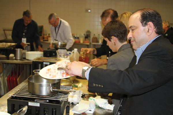 Daniel Hoffman, Marriott International, working on his team's dish.
