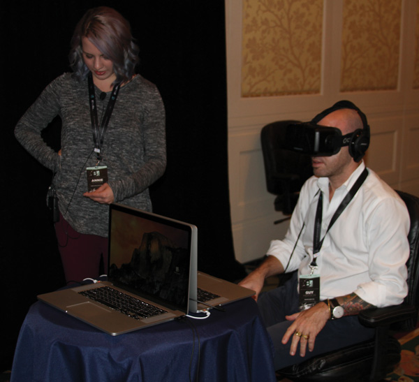 Annie Eaton sets up a guest for a virtual reality experience.