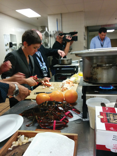 Hilary Leister, IHR, cutting up fresh lobsters for her team's dish.