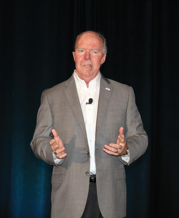 Larry McGinn, president of IMI Agency, introduces the keynote speaker.