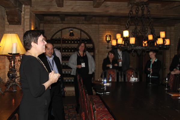 Ryanne Carrier, Sea Island director of Wine & Spirits, welcomes a group to the Cloister's wine cellar.