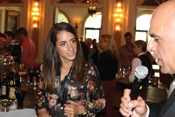 Tony Abou-Ganim asks Shannon Battista, IMI, about her cocktail.