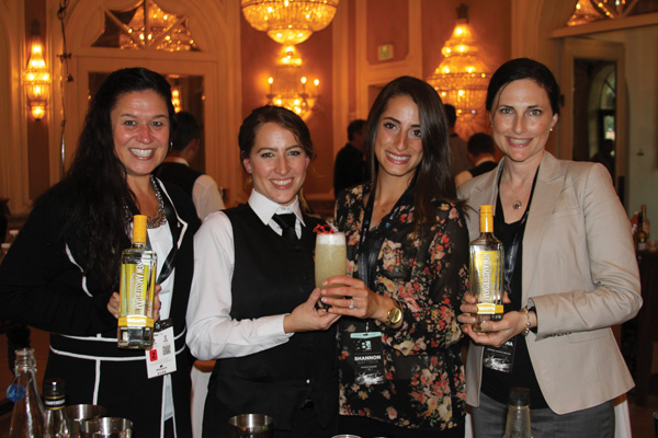 The winning cocktail was mixed by Cloister bartender Nicole Irish and Shannon Battista, IMI (center). Sue Mills (left) and Christina Moore (right), representatives from the spirit sponsor, New Amsterdam Pineapple.
