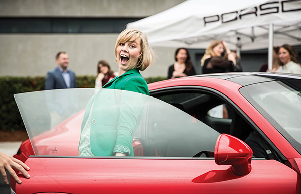Amanda Miles of IMI Atlanta is WOWED by her over 100 miles-per-hour run around the track in the Porsche Experience.