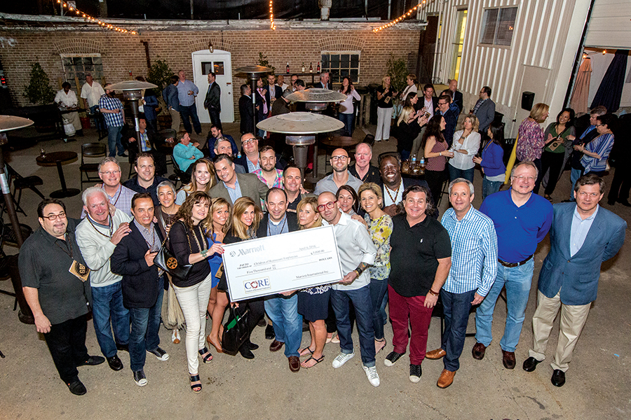 The group of CORE supporters at the Marriott Global Beverage Partners meeting holding a check for $5,000 from Marriott International.