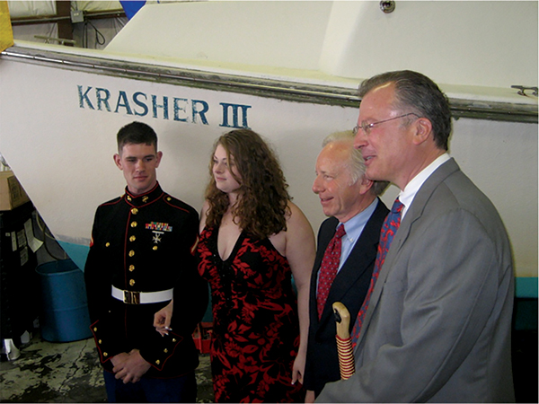 John Niekrash (right) at his very first Work Vessels for Vets presentation, the donation of his lobster boat, Krasher III, to veteran Richard Giguere (left) and his wife. Also in attendance was Senator Joseph Lieberman.