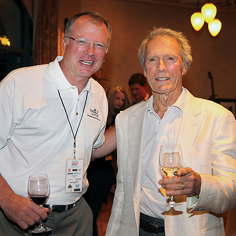 John Niekrash with Clint Eastwood at a presentation.