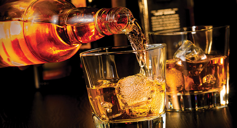 bigstock-barman-pouring-whiskey-in-fron-65925994