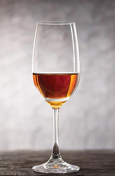 Glass of amontilliado sherry-jerez wine on wooden plank