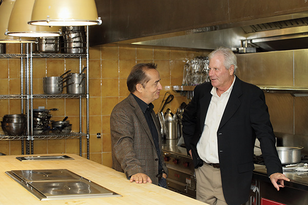 Wolfgang Lindlbauer and Mike Raven in the test kitchen inside Marriott International's headquarters.
