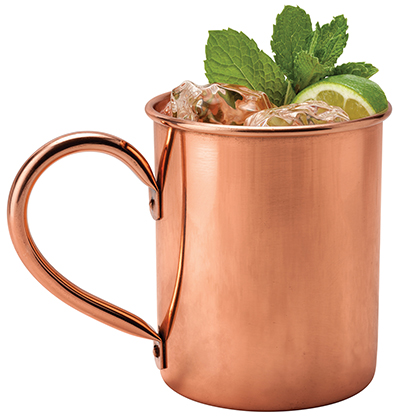Moscow Mule in a Copper Mug. This is a Vodka drink served with mint and a garnished with a wedge of lime The image is a cut out isolated on a white background and includes a clipping path.